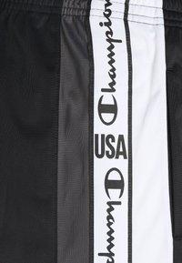 Champion - STRAIGHT HEM PANTS - Tracksuit bottoms - black - 5