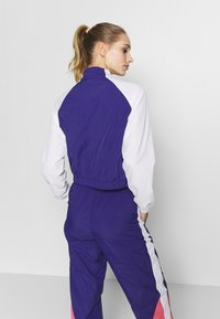 Puma - STUDIO CLASH ACTIVE TRACK JACKET - Treningsjakke - purple - 2