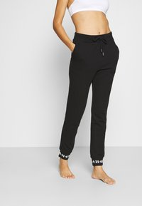 Diesel - UFLB ALINA TROUSERS - Pyjama bottoms - black - 0
