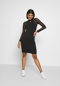 Puma - BODYCON DRESS - Vestido de tubo - black - 1