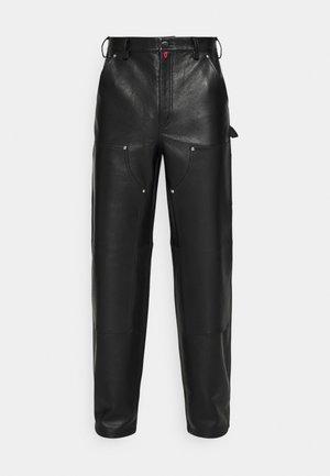 WORK PANTS UNISEX - Leather trousers - black