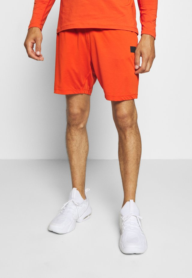 ELASTIC SHORTS - Sports shorts - intense orange