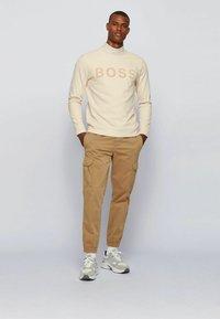 BOSS - Cargo trousers - beige - 1