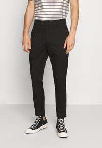 Antony Morato - TROUSERS JAGGER CARROT FIT IN STRETCH FABRIC - Trousers - black - 0
