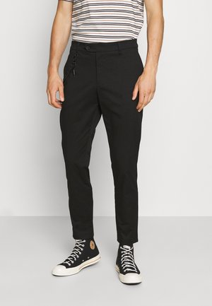 TROUSERS JAGGER CARROT FIT IN STRETCH FABRIC - Kangashousut - black