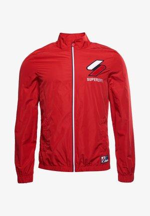 CAGOULE - Training jacket - varsity red