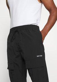 WRSTBHVR - TROUSER HYDRO UNISEX - Cargo trousers - black - 3