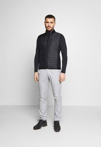 Calvin Klein Golf - WRANGELL HYBRID GILET - Waistcoat - black - 1