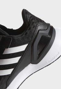 adidas Performance - RAPIDARUN UNISEX - Neutrální běžecké boty - black - 7
