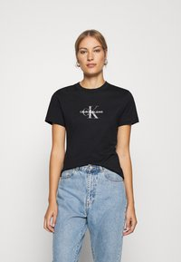 Calvin Klein Jeans - GLITTER MONOGRAM TEE - Print T-shirt - black - 0
