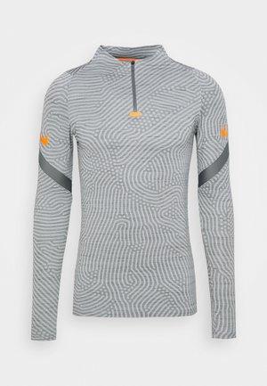 DRY STRIKE DRILL - Sports shirt - smoke grey/total orange
