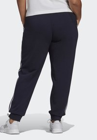 adidas Performance - ADIDAS ESSENTIALS FRENCH TERRY 3-STRIPES PANTS (PLUS SIZE) - Tracksuit bottoms - legink/white - 1