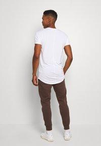 Nike Sportswear - CLUB - Tracksuit bottoms - baroque brown - 2