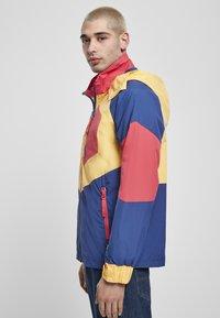 Starter - MULTICOLORED LOGO - Kevyt takki - red/blue/yellow - 3