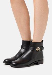 MICHAEL Michael Kors - ABIGAIL FLAT BOOTIE - Classic ankle boots - black - 0