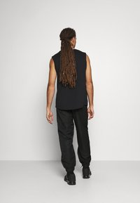 NU-IN - SHELL JOGGERS - Tracksuit bottoms - black - 2