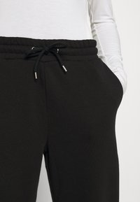 Monki - Tracksuit bottoms - black - 5