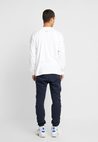 adidas Originals - OUTLINE REGULAR TRACK PANTS - Träningsbyxor - legend ink/white - 2
