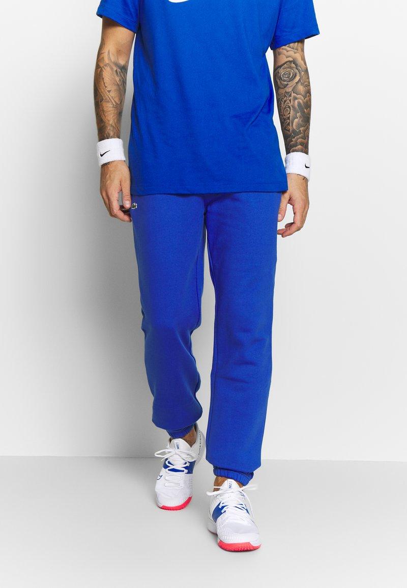 Lacoste Sport - HERREN - Träningsbyxor - blue