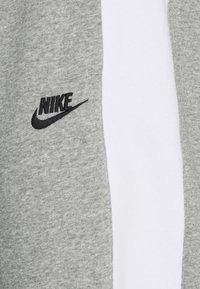 Nike Sportswear - Tracksuit bottoms - dark grey heather/white/charcoal heather/black - 2