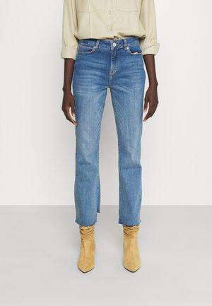 MALCOLM KICK  - Flared Jeans - denim blue