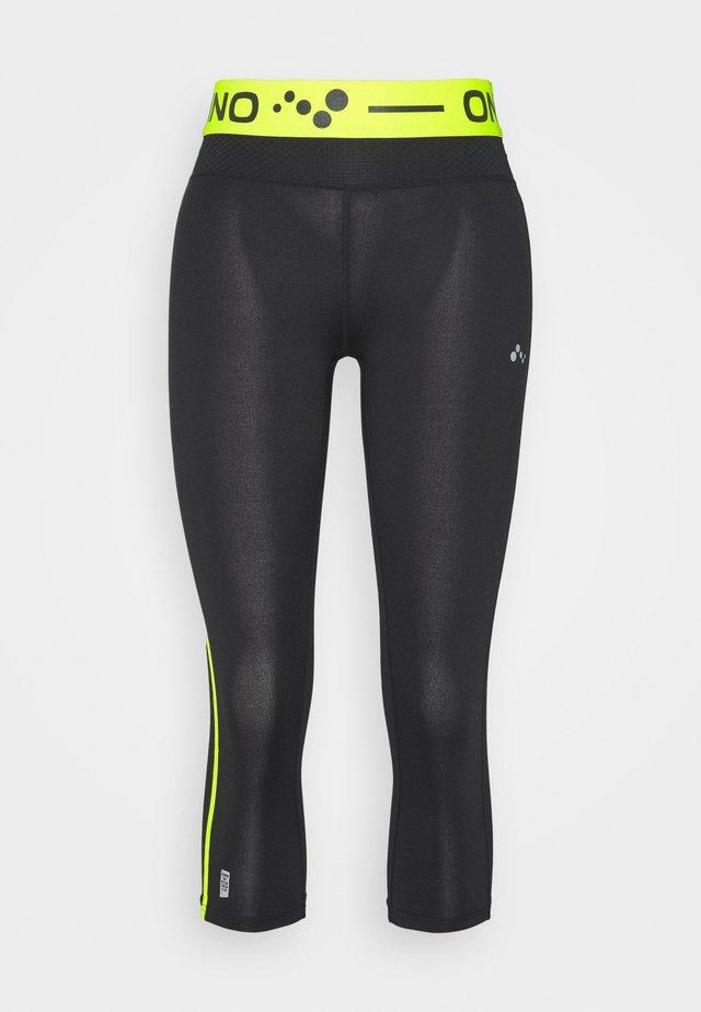 ONPJACEI TIGHTS - Leggings - black/saftey yellow