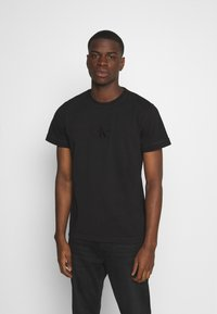 Calvin Klein Jeans - ACID WASH TEE - Basic T-shirt - black - 0