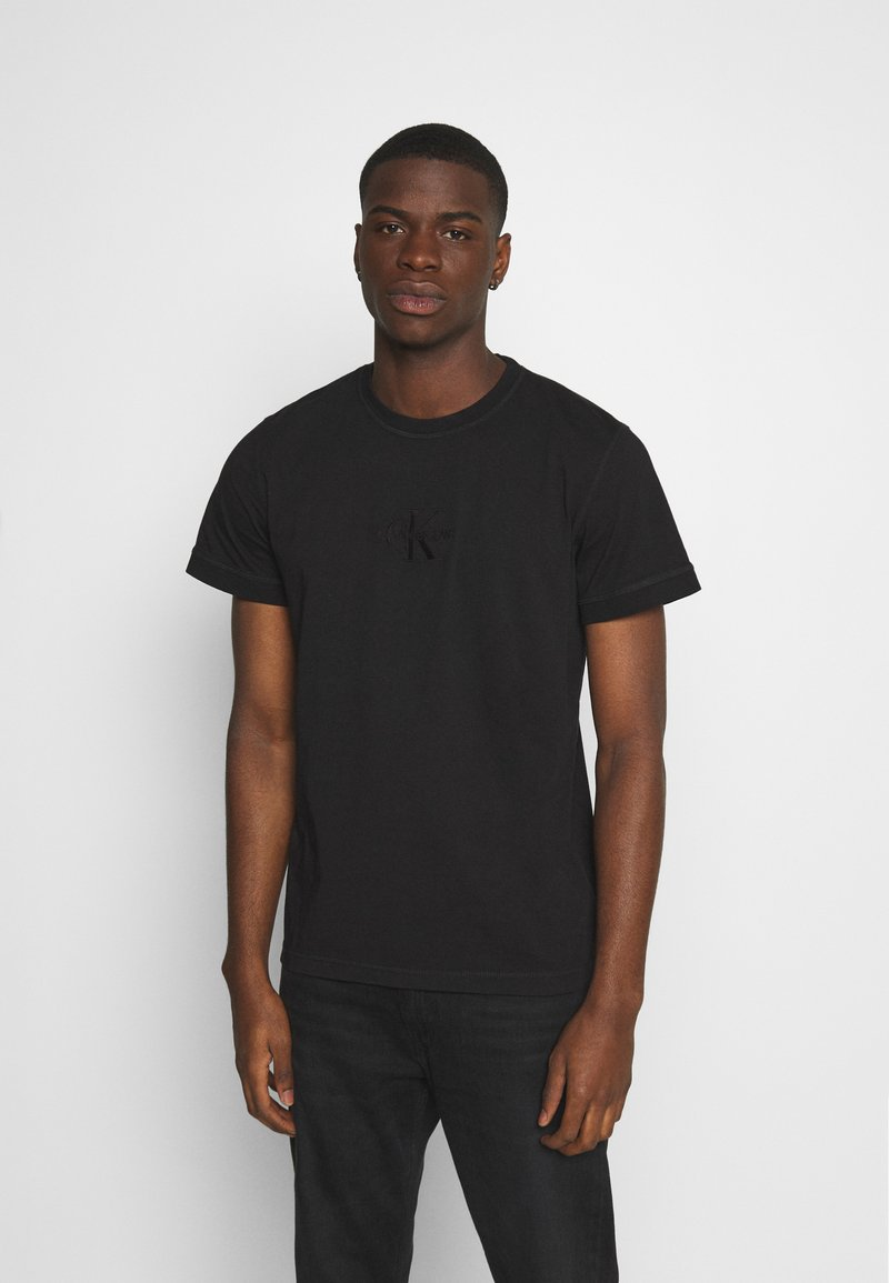 Calvin Klein Jeans - ACID WASH TEE - Basic T-shirt - black