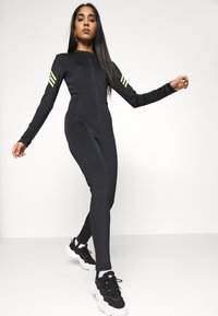 adidas Originals - SWAROVSKI STAGE SUIT - Jumpsuit - black - 3