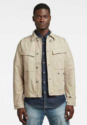 SHORT BIKER OVERSHIRT - Summer jacket - beige