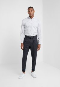 GTA - RORY - Trousers - navy - 1