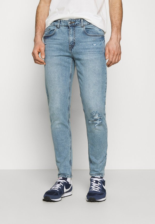 NEPARIS TINTED LIGHT BLUE JEANS UNISEX - Jeans Tapered Fit - light blue
