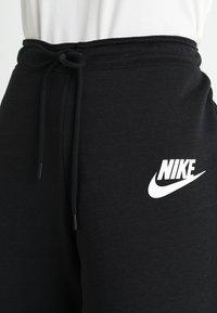 Nike Sportswear - RALLY - Tracksuit bottoms - black - 4