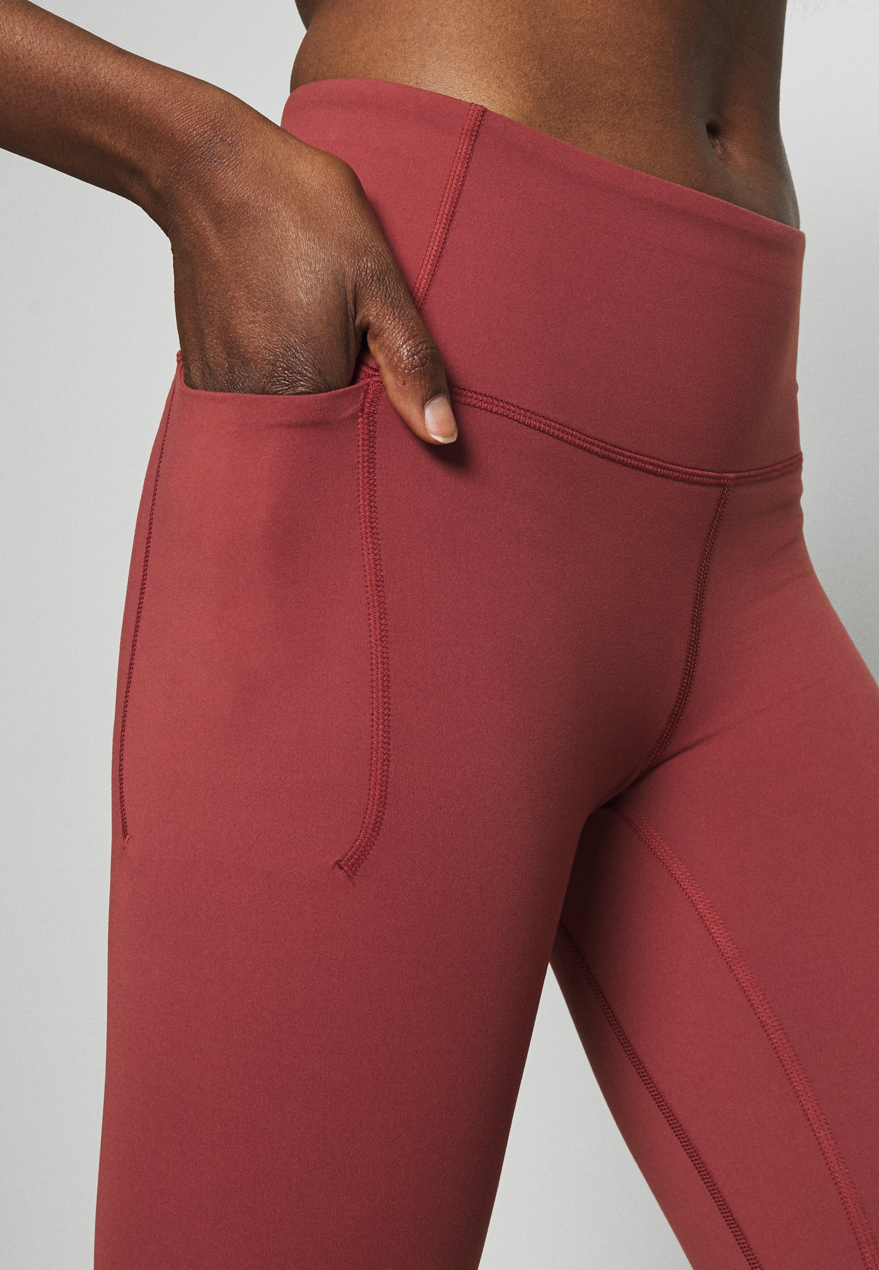 Under Armour UA MERIDIAN LEGGINGS - Leggings - cinna red 4przI