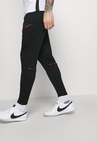 Nike Performance - ACADEMY 21 PANT - Tracksuit bottoms - black/siren red - 3