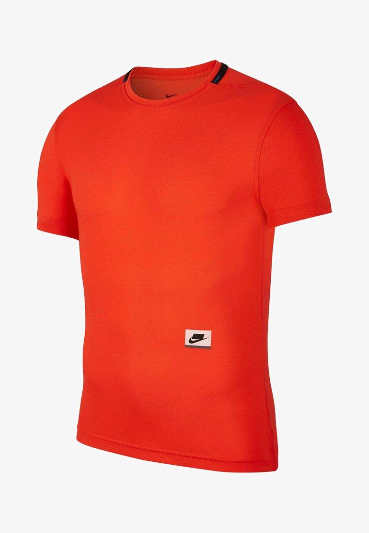 Nike Performance - Basic T-shirt - red