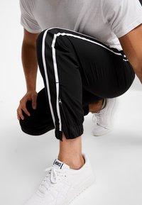 Calvin Klein Jeans - SIDE STRIPE TRACK PANT - Tracksuit bottoms - black - 5