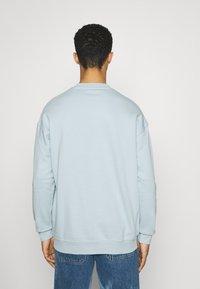 YOURTURN - UNISEX - Sweatshirt - light blue - 2