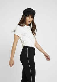 ONLY Petite - ONLEVIE  ANKLE  PIPING - Leggings - Trousers - black - 3