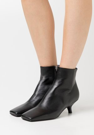 HOLLY - Classic ankle boots - nero