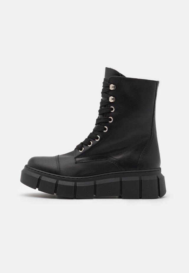 FUNKY - Platform ankle boots - black
