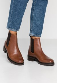 KIOMI - Winter boots - brown - 0