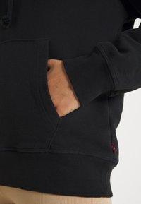 Levi's® - GRAPHIC STANDARD HOODIE - Sweat à capuche - black - 5