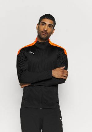 FTBLNXT TRACK JACKET - Veste de survêtement - black/shocking orange