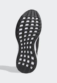 adidas Performance - RAPIDARUN UNISEX - Neutrální běžecké boty - black - 4