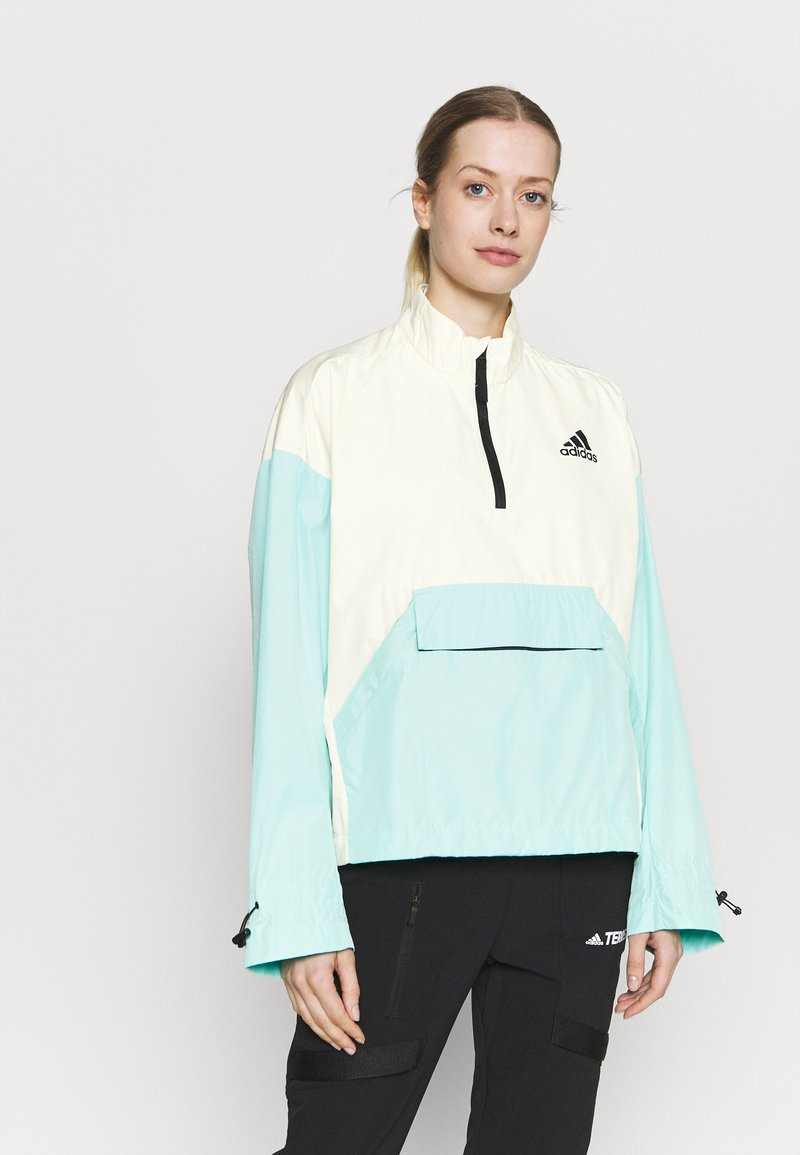 adidas Performance - Back-to-School W.R ANORK URBAN WIND.RDY OUTDOOR RELAXED JACKET - Windbreaker - cream white/clear mint