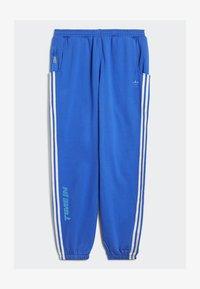 adidas Originals - NINJA PANT UNISEX - Tracksuit bottoms - blue - 5