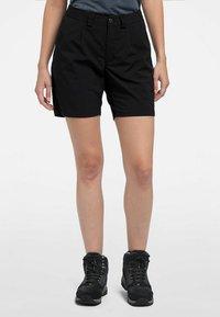 Haglöfs - MID SOLID SHORTS - Outdoor shorts - true black - 0