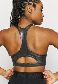 Nike Performance - BRA - Medium support sports bra - black/metallic gold - 4