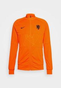 NIEDERLANDE KNVB - Pelipaita - safety orange/black